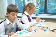 Children drawing. The girl and the boy are drawing stock image