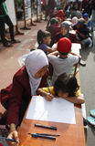 Children drawing batik pattern Royalty Free Stock Photos