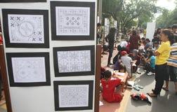 Children drawing batik pattern Stock Images