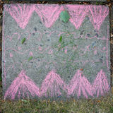 Children drawing with chalk on asphalt. Children drawing with chalk on asphalt tail Royalty Free Stock Images