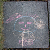 Children drawing with chalk on asphalt. Royalty Free Stock Photo