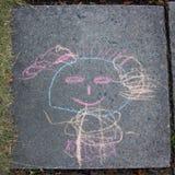 Children drawing with chalk on asphalt. Children drawing with chalk on asphalt tail Royalty Free Stock Photo