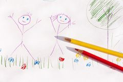 Children drawing with colored pencils on paper royalty free stock photo