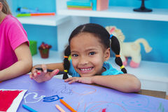 Children drawing on coloured paper Royalty Free Stock Photos