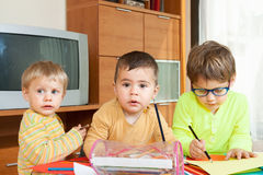 Children drawing with crayons royalty free stock image