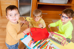 Children drawing with crayons Stock Photo