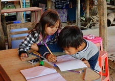 Children drawing at the house in Inlay Lake, Myanmar Stock Photos