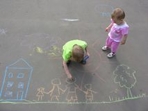 Children Drawing On Asphalt Royalty Free Stock Photos