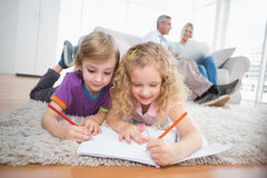 Children drawing on papers at home Royalty Free Stock Photos