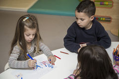 Children drawing at playroom. Children drawing in the playroom Stock Images