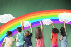 Free Children Drawing Rainbow And Cloud On The Chalkboard Stock Photos - 157362833