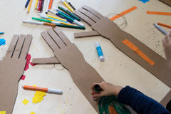 Children is drawing a robotic arm made with cardboard. Cardboard. Children is wearing a robotic arm made with cardboard. Cardboard STEAM activities for kids at Royalty Free Stock Photography