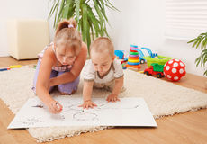 Children drawing in room Royalty Free Stock Photography