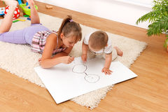 Children drawing in room Stock Photo
