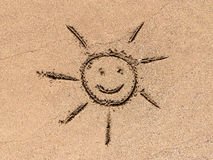 Children Drawing Of Sun Sign On Beach Sand Royalty Free Stock Photos