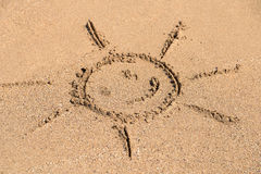 Children Drawing Of Sun Sign On Beach Sand Stock Photos