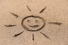 Children Drawing Of Sun Sign On Beach Sand Royalty Free Stock Images