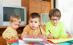 Children drawing at  table. Royalty Free Stock Image