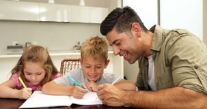 Children drawing with their dad at the table Royalty Free Stock Images