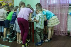 Children drawings around the table in the kindergarten. 2019.01.22, Moscow, Russia. Children drawings around the table in the kindergarten. Group of funny boys stock photography