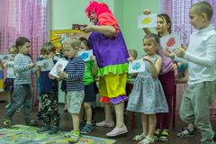 Children drawings around the table in the kindergarten. 2019.01.22, Moscow, Russia. Children drawings around the table in the kindergarten. Group of funny boys stock photo