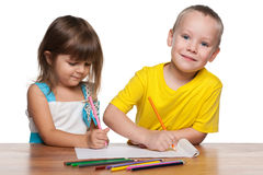 Children draws at the desk Stock Images