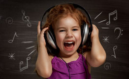 Children dream. Beauty child at the blackboard Royalty Free Stock Photos