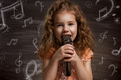 Children dream. Beauty child at the blackboard Stock Images