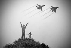 Children dream of becoming pilots. Children and two aircraft flying over them Stock Images