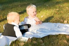 Children dressed as bride and groom Stock Images