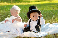 Children dressed as bride and groom Stock Image