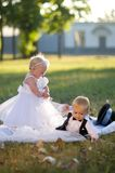 Children dressed as bride and groom Royalty Free Stock Photo