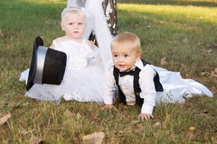 Children dressed as bride and groom Royalty Free Stock Photography
