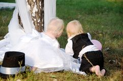 Children dressed as bride and groom Stock Photos