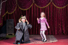 Children Dressed as Clowns Performing on Stage Stock Photos