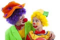 Children dressed as colorful funny clowns Stock Image