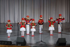 Children dressed as hussars on stage  performs Stock Photo