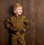 Children are dressed as soldier in retro military uniforms royalty free stock image