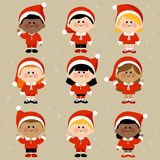 Children dressed in Christmas costumes. A happy group of multicultural boys and girls children dressed in Christmas Santa Claus costumes Royalty Free Stock Photos