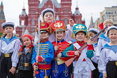 Children dressed in costumes on Red Square Stock Photography