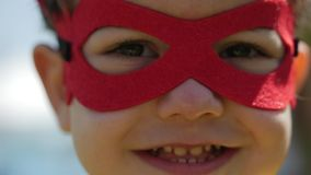 Children Dressed in Superhero Costumes, Cloaks and Masks Play Heroes and Have Fun in the Summer Glade in the Park