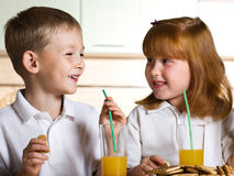 Children drink juice Royalty Free Stock Image