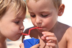 Children drink juice Royalty Free Stock Photos