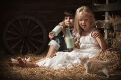 Children drink milk in the barn Stock Photos