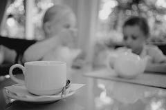 Children drink tea in cafe Stock Photography