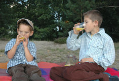 Children drinking juice Royalty Free Stock Photography