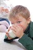 Children drinking milk Royalty Free Stock Images