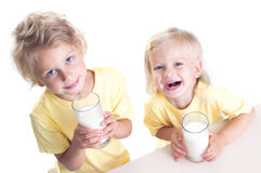 Children drinking milk Royalty Free Stock Photography