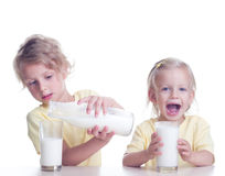 Children drinking milk Stock Images