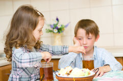 Children drinking tea Stock Photos